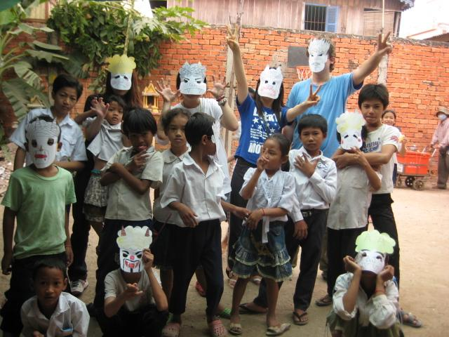 Students pose with their handmade masks at one of our teaching placements in Cambodia